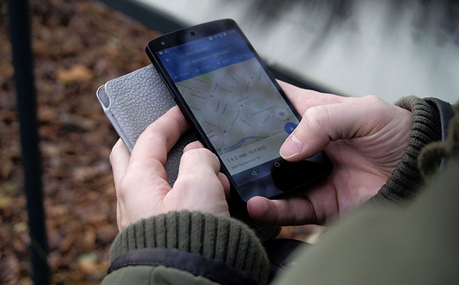 Person viewing map on phone